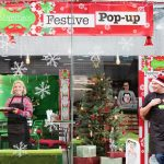 Martha's Festive Pop Up on Byres Road in Glasgow's West End. Pictured L to r Katie Talbot (front of house) in the window , Shannon Easter operations manager at the till and founder Gavin Clark outside. Photograph by Martin Shields Tel 07572 457000 www.martinshields.com © Martin Shields
